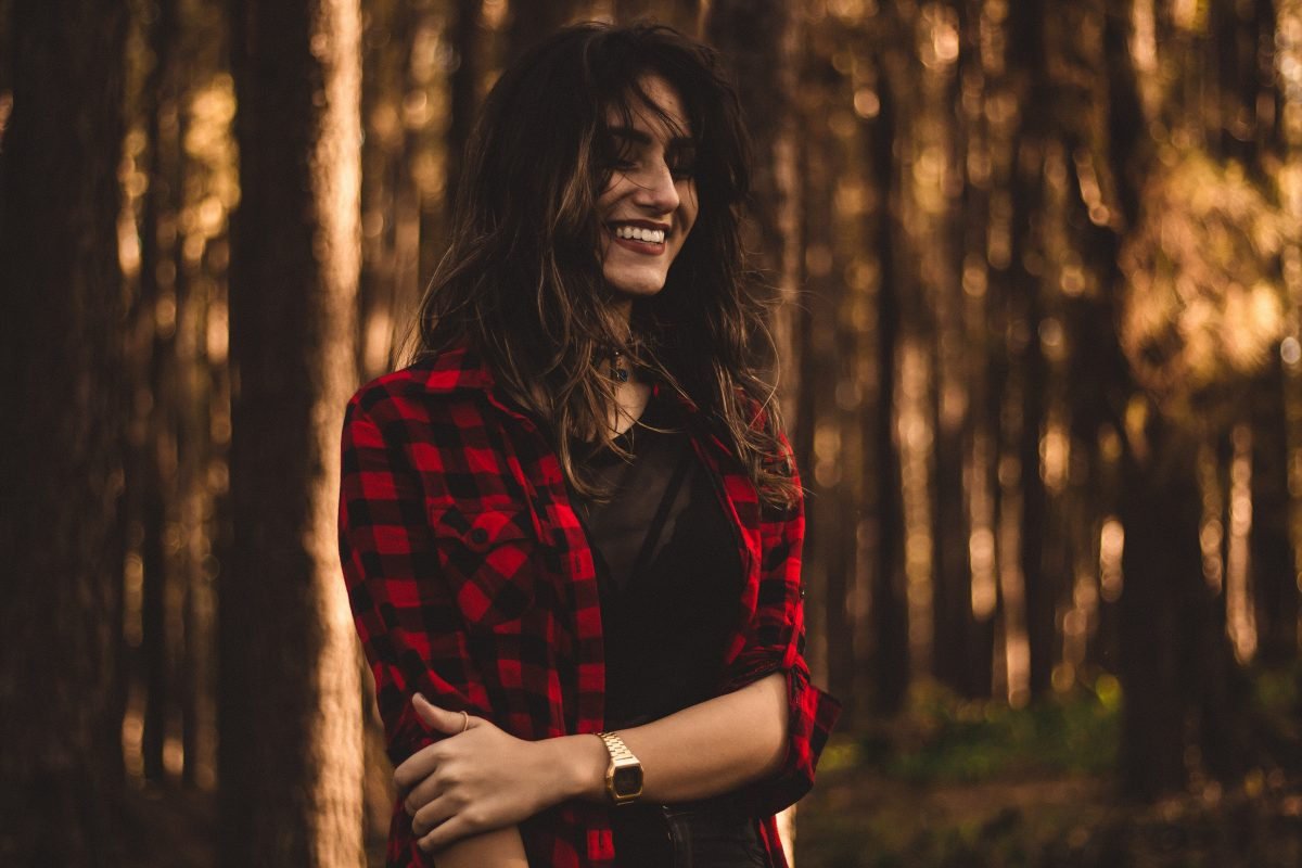 girl wearing plaid flannel shirt