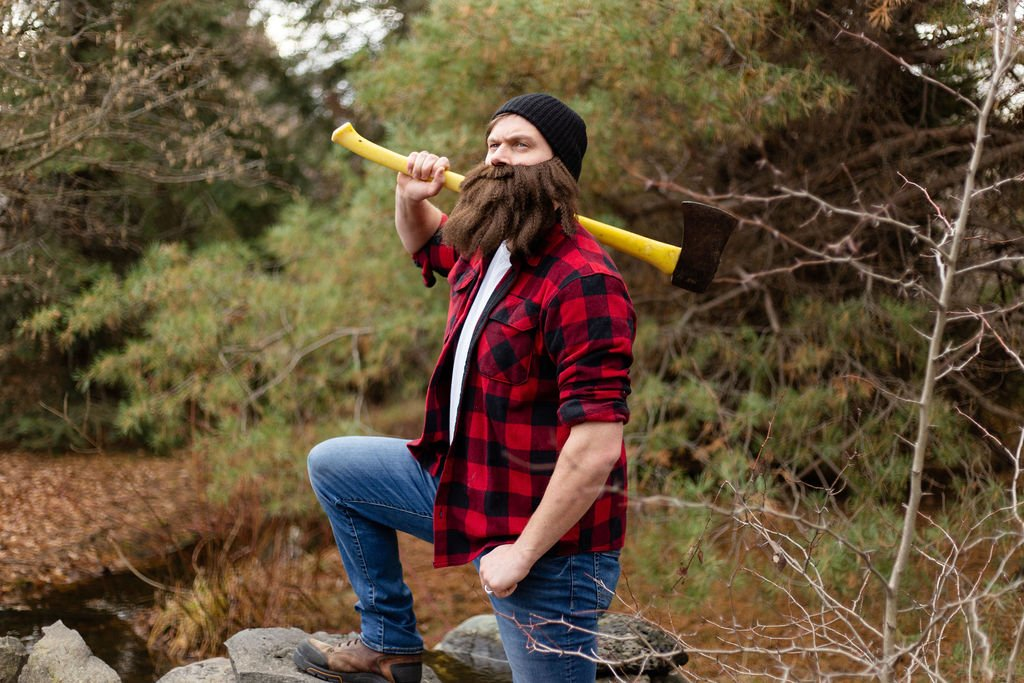 Heber the Hatchets man in the woods holding an axe