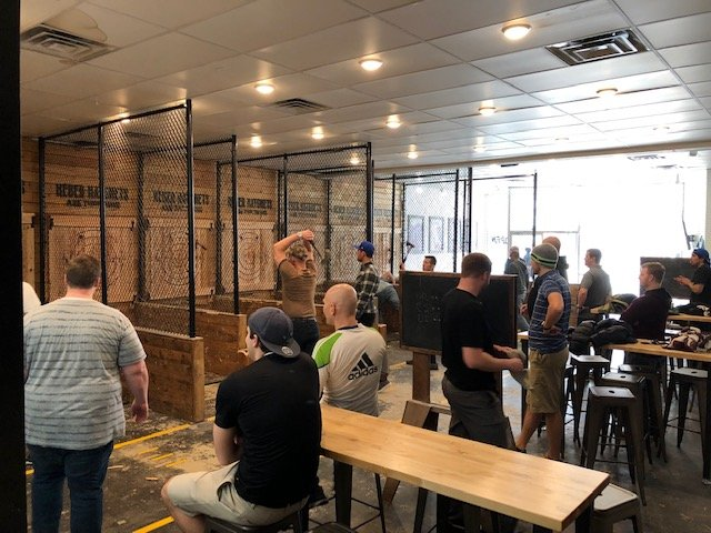 a group throws axes during a corporate event at Heber Hatchets