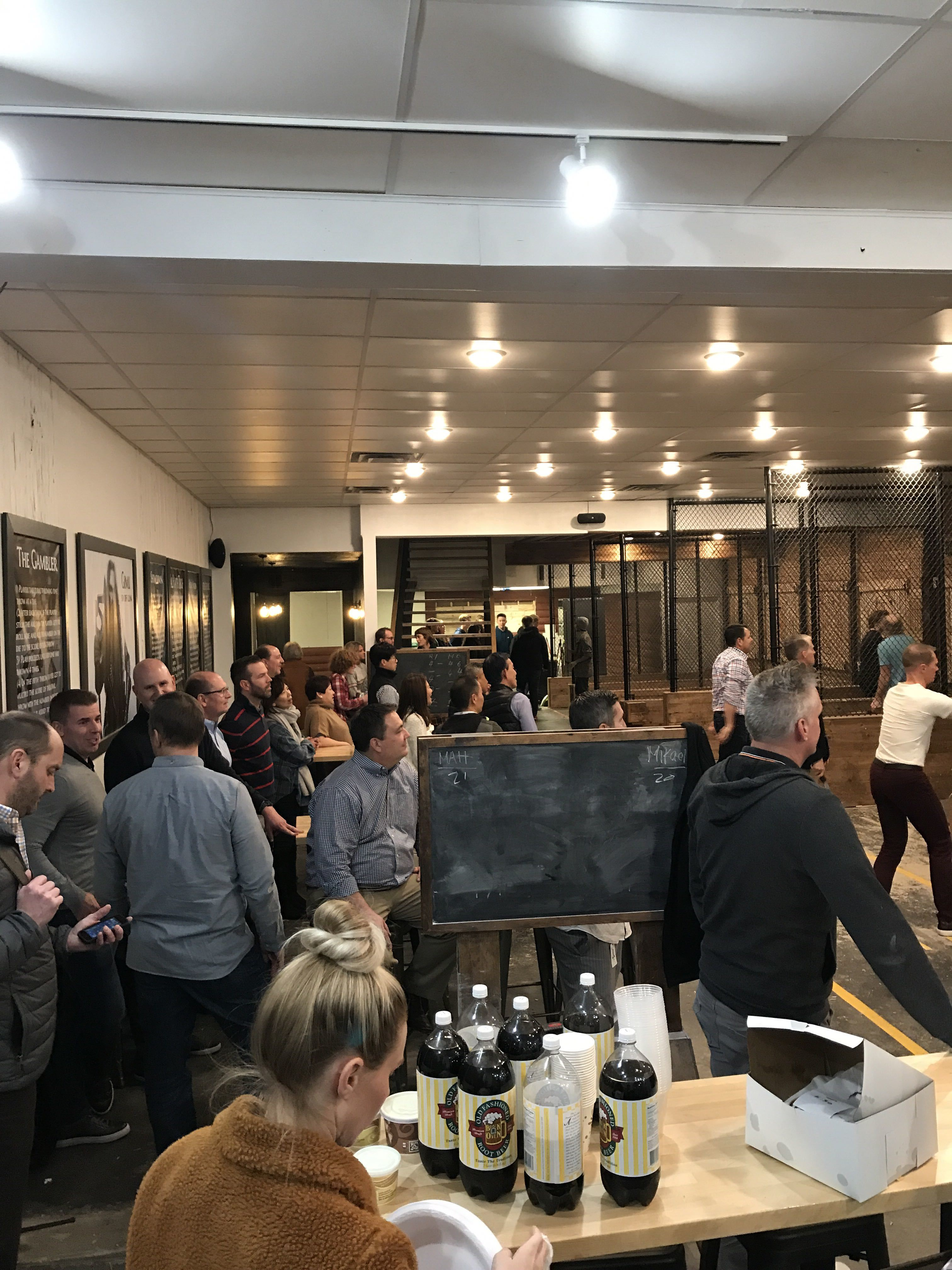 a business group enjoys food and axe throwing during a corporate event at Heber Hatchets
